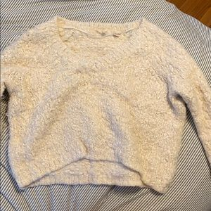 Knitted and knotted fuzzy cropped sweater